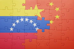 Intryguje z flaga państowowa Venezuela i porcelana Obrazy Stock