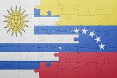 Intryguje z flaga państowowa Venezuela i Uruguay Fotografia Royalty Free
