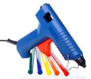 Intsrument for repair and design works - the glutinous gun and color cores. Still-life on a white background Stock Images