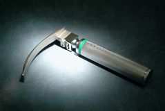 Intubaton tool. Intubation tool (laryngoscope) in a spotlight Stock Photo