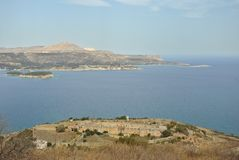 Intzedin Fort and Souda Bay in Crete, Greece. The view of Intzedin Fort, a former Greek political prison and execution site, acros Souda Bay harbour to Akrotiri Stock Photos