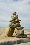 Inuit Inukshuk. An Inuit Inukshuk on the shore of Peggy's Cove, Nova Scotia stock photography