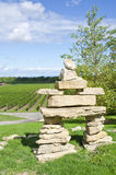 Inuit Inukshuk Standing in a Vineyard #2 Stock Image