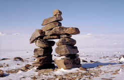 Inuit monument. Arctic : to find its direction and its way Stock Photos