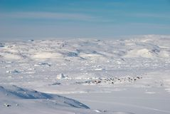 Inuit village. An inuit village lost in a snowy landscape stock photography
