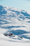Inuit village. A small inuit village lost in a snowy landscape stock images
