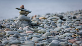 Inukshuk στην ακτή στην ανατολική μετάβαση, Καναδάς Στοκ Φωτογραφίες