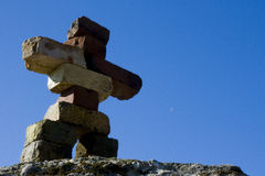 Inukshuk. (Vancouver 2010 olympics logo) made out of bricks from an old sawmill in Port Moody, British Columbia royalty free stock image