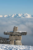 Inukshuk. An inukshuk stands guard over Whistler Mountain, British Columbia, Canada Stock Photos