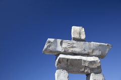 Inukshuk and Blue Sky. The top of the inukshuk on Whistler Mountain against a clear blue sky. The inukshuk is the symbol of the 2010 Winter Olympic Games in stock image