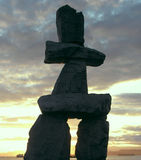 Inukshuk Canada. Inukshuk at English Bay in Vancouver at sunset, Canada Stock Image