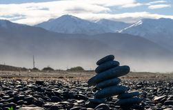 Inukshuk in front of mountains stock images