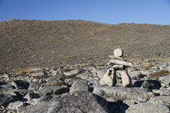Inukshuk or Inuksuk along a hiking trail near the community of Qikiqtarjuaq, Broughton Island. Nunavut, Canada Stock Photo