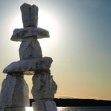 Inukshuk landmark at dusk. Inukshuk monument in English Bay, Vancouver stock photo