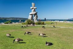 Inukshuk Monument at English Bay, Vancouver. B.C., Canada September 2017 royalty free stock image