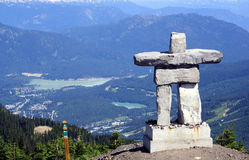 Inukshuk at Mt Whistler, Canada. Inukshuk and Canadian Rockies at Mt Whistler, Canada Stock Image