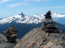 Inukshuk at Mt Whistler summit. Royalty Free Stock Images
