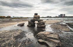 Inukshuk on the Ottawa River. Stone sculptures known as Inukshuks line in the Ottawa River, Canada Royalty Free Stock Images