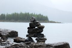 Inukshuk in rain Royalty Free Stock Images