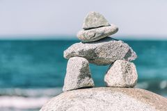 Inukshuk Rock balancing. In Vancouver stone stacking garden & x28;English Bay Beach& x29 stock photos