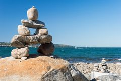 Inukshuk Rock balancing. In Vancouver stone stacking garden English Bay Beach stock photography