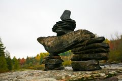 An Inukshuk on the Rocks. In Whitney, Ontario Royalty Free Stock Image