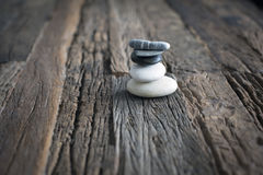 Uncompleted Inukshuk rocks on wooden table`. Inukshuk, Inuit Art on a nice wooden table. Let us think that the work is not finished Royalty Free Stock Images