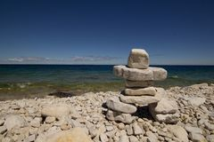 Inukshuk,Rocky beach, Georgian Bay, Bruce Peninsula, lake Huron Stock Images