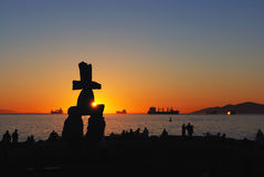 Inukshuk sculpture at sunset Stock Photography