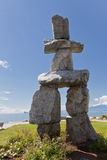 Inukshuk in Stanley Park. The Inukshuk, a stone human like eskimo figure that is a symbol for Canada in Stanley Park, Vancouver stock photography