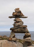 Inukshuk. A stone monument over looking the ocean Stock Photos