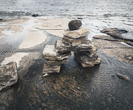 Inukshuk. Stone sculptures known as Inukshuks line in the Ottawa River, Canada Stock Images