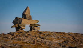 Inukshuk symbol on a boulder in Newfounland and Labrador Stock Images