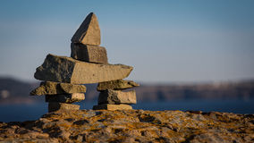Inukshuk symbol on a boulder in Newfounland and Labrador Stock Photos