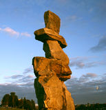 Inukshuk Vancouver, Canada. Inukshuk at English Bay in Vancouver at sunset, Canada Stock Photography