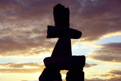 Inukshuk in Vancouver, Canada. Inuit Inukshuk silhouette against the sunset in Vancouver, Canada royalty free stock photography