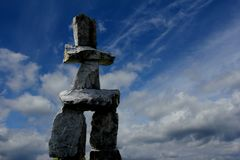 Inukshuk of Vancouver, English Bay. At dusk royalty free stock photography