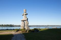 Inukshuk in vancouver at English bay. Close to the sea a sunny day stock photos