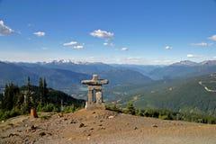Inukshuk at Whistler Blackcomb Mountain. View from the Peak of Whistler Blackcomb Mountain to the Inukshuk stock images