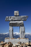 Inukshuk on Whistler Mountain. An Inukshuk, the symbol of the 2010 Winter Olympic Games in Vancouver and Whistler, British Columbia, Canada, towers over the royalty free stock photos