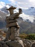 Inukshuk y glaciar Imagen de archivo libre de regalías