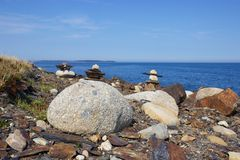 Inukshuks on rocky Nova Scotia, Canada coastline Stock Image
