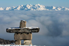 Inuksuk. An inuksuk stands guard over Whistler Blackcomb, British Columbia, Canada Royalty Free Stock Images