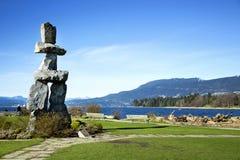 Inuksuk in English bay in Vancouver Stock Image
