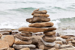 Inuksuk or Inkukshuk on the Huron lakeshore Stock Image