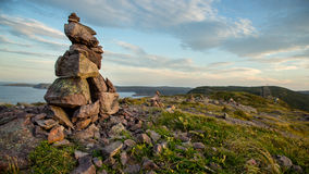 Inuksuk (Inukshuk) on Signal Hill, St. John's, Newfoundland. Located in St. John's, Newfoundland and Labrador, Signal Hill is a popular tourist attraction royalty free stock image