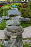 Inuksuk in the Park. An inuksuk (or cairn) in a park, marking a trail Royalty Free Stock Photography