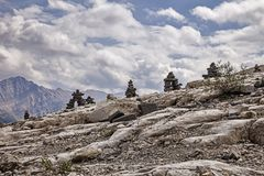 Inuksuk Ridge. A row of Inukshuk figures line the ridgeline of a portion of the Iceline Trail in Yoho National Park in Canada Royalty Free Stock Photography
