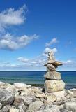 Inuksuk on rocky coast Stock Photo