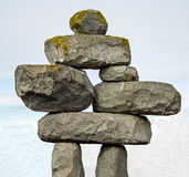 Inuksuk - A Stone Sculpture in the form of a Person - along the. Road in Canada Royalty Free Stock Photo
